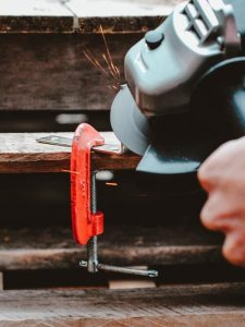 close up of circular saw and clamp