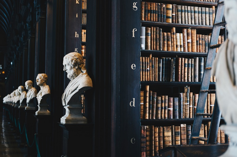 Libary stacks with statues