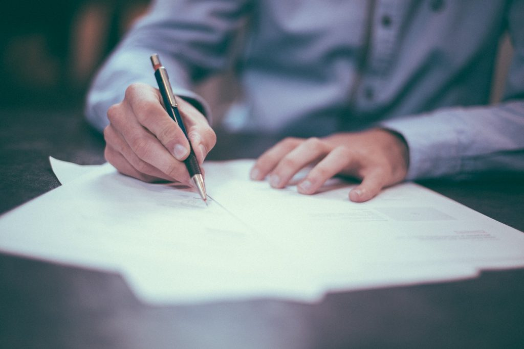 Business person signing documents