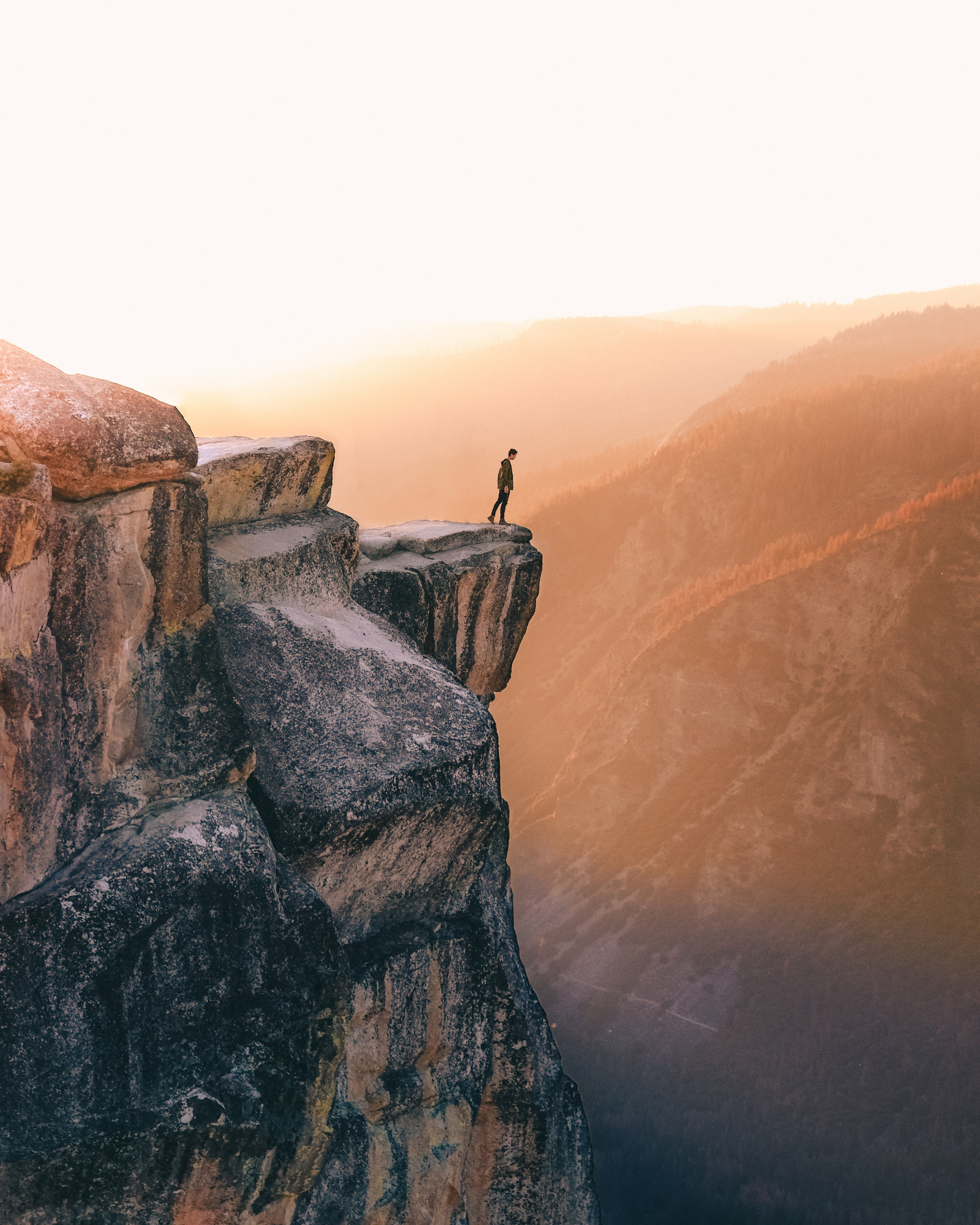 Person standing on the edge of a cliff