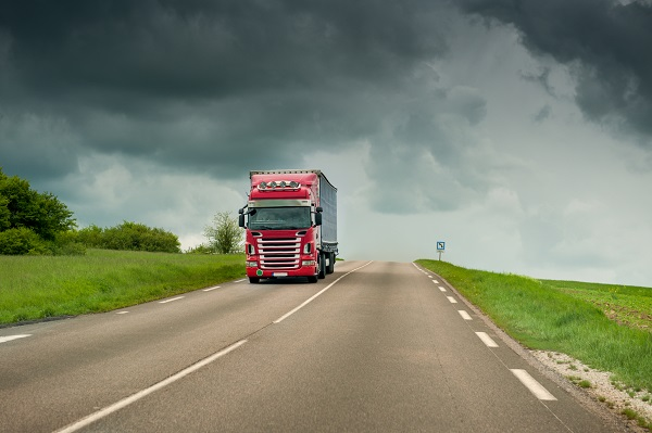 truck on highway with stormy weather